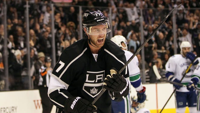 Los Angeles Kings forward Jeff Carter celebrates his second period goal in the team's 3-2 comeback win. Carter netted the lone goal in the shootout to secure two points for the Kings.