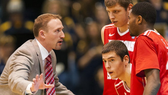 Illinois State head coach Dan Muller talks with players during the second half of a game against Drexel earlier this season.