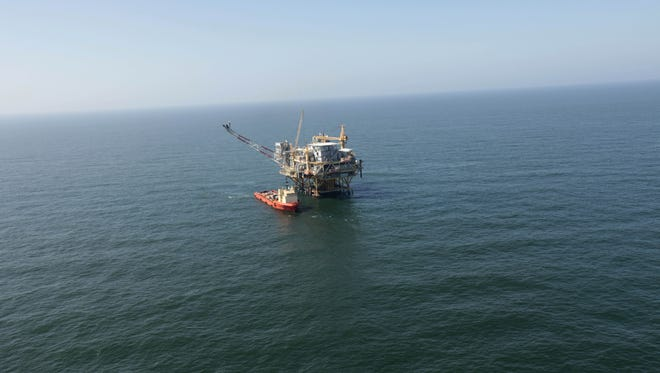 A rig and supply vessel in the Gulf of Mexico, off the cost of Louisiana, near where the 2010 BP oil spill occurred.
