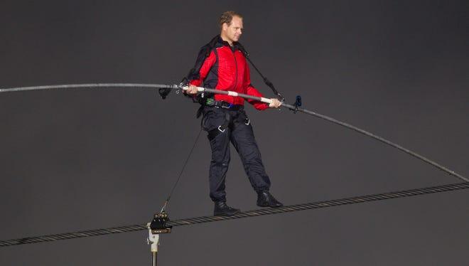 Tightrope walker Nik Wallenda crosses Niagara Falls on a wire last June.