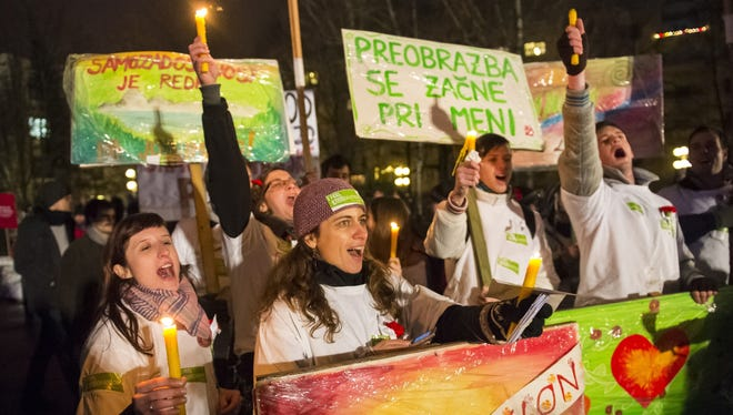 Demonstrators sing during an anti-government protest in Ljubljana, Slovenia, on Dec. 21.