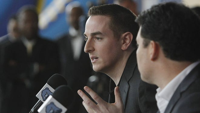 Memphis Grizzlies basketball new chairman Robert Pera, left, gestures while speaking during a press conference, as new chief executive officer Jason Levien looks on.