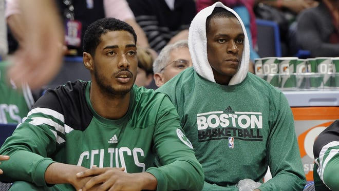 Boston Celtics' Fab Melo, left, was recalled to the team on Tuesday. Rajon Rondo, right, is out with a torn ACL.