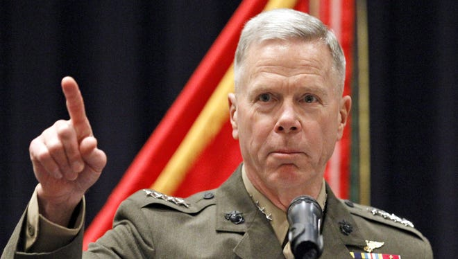 Gen. James Amos, Marine Corps commandant, says Marines will not lower physical standards for certain specialties.