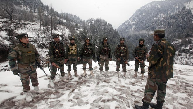 An Indian army officer briefs soldiers this month near the Line of Control, which divides Kashmir between India and Pakistan.