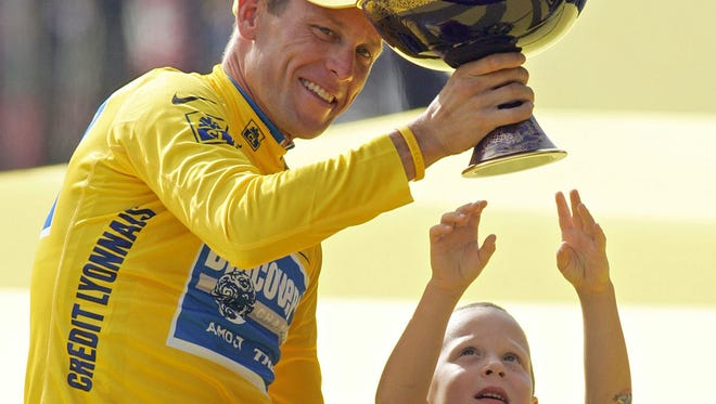After Lance Armstrong won his seventh consecutive Tour de France, in July 2005, his son Luke tries to touch the trophy. Armstrong, in his January interview with Oprah Winfrey, said having his son deal with all the reports and rumors regarding his dad's alleged doping finally persuaded Armstrong to come clean with the extent of his deceit.