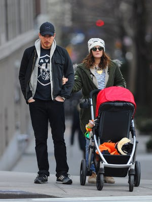 Drew Barrymore and husband Will Kopelman go for a walk with baby Olive in New York.