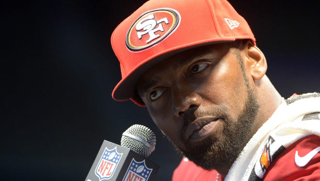 49ers wide receiver Randy Moss (84) addresses the press during media day in preparation for Super Bowl XLVII.