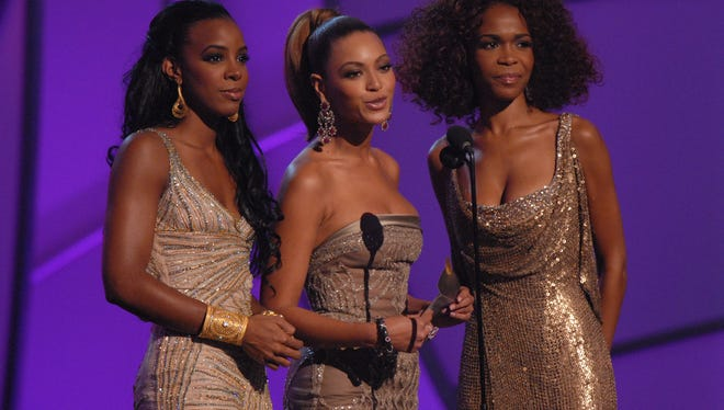 Kelly Roland, left, Beyonce and Michelle Williams,   are members of Destiny's Child.