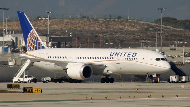 A grounded Boeing 787 Dreamliner jet operated by United Airlines is parked at Los Angeles International Airport (LAX) on January 9, 2013 in L.A.