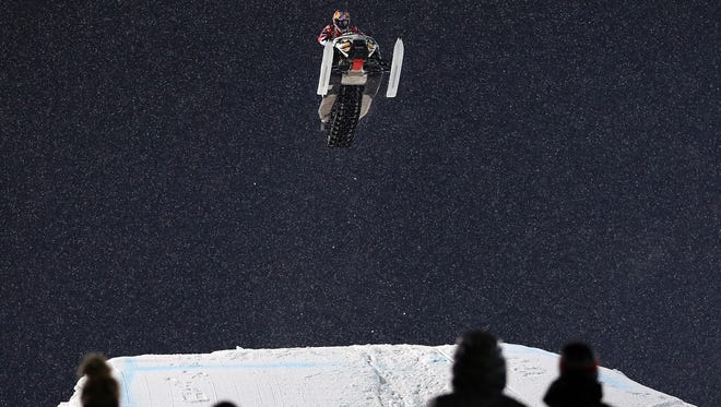 = Levi LaVallee goes airborne en route to winning the golf medal in the snowmobile freestyle final at Winter X Games in Aspen, Colo., on Jan. 25.