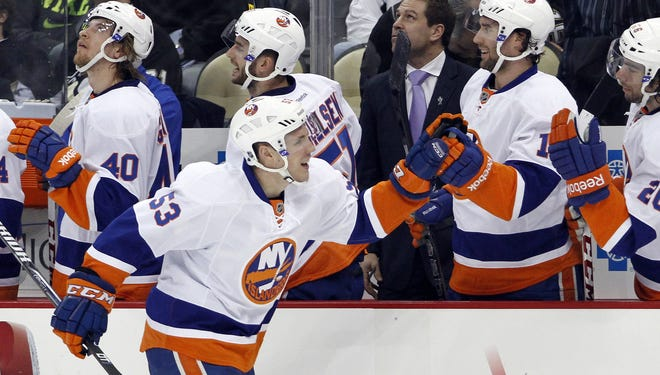 The New York Islanders' Casey Cizikas celebrates his first NHL goal in Tuesday's win against the Pittsburgh Penguins.