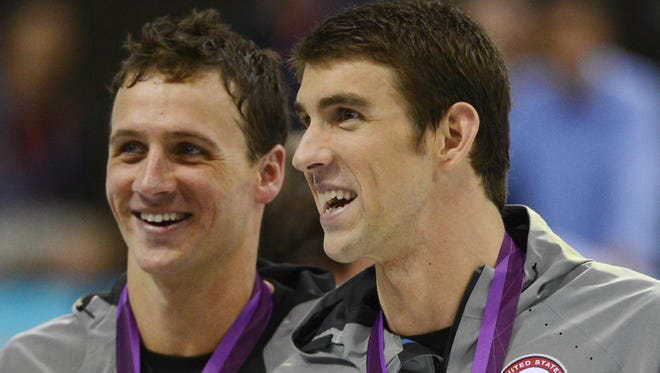 Michael Phelps, right, and Ryan Lochte show off their gold (Phelps) and silver medals after the men's 200m individual medley final during the London Olympics.