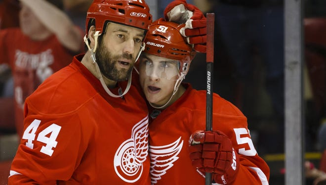 Detroit Red Wings center Valtteri Filppula, right, is congratulated byright wing Todd Bertuzzi over his first goal.