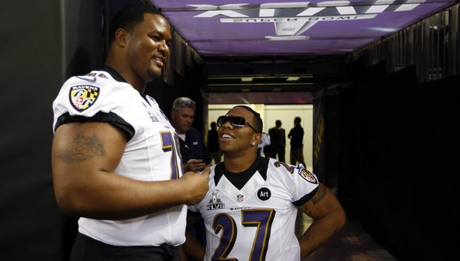 Baltimore Ravens running back Ray Rice (27) and tackle Bryant McKinnie (78) stand in the tunnel as they wait for the start of media day in preparation for Super Bowl XLVII against the San Francisco 49ers at the Mercedes-Benz Superdome.