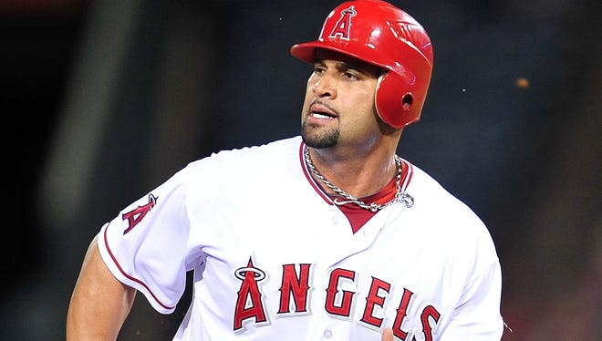 Los Angeles Angels first baseman Albert Pujols advances to third in the first inning against the Detroit Tigers at Angel Stadium.