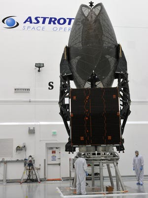 Workers at AstroTech prepare the TDRS-K satellite for its scheduled launch Jan. 30.