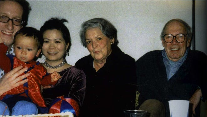 Annette and Stanley Karnow celebrate his birthday in 1999 jointly with 1-year-old Hanh-Thien, held by parents Bob and Thuan Elston.