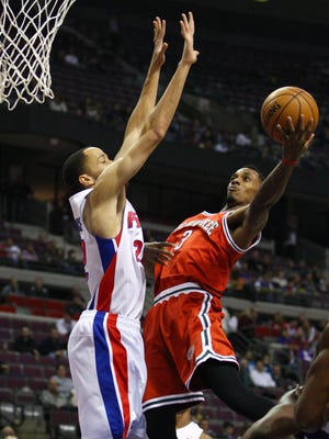 Bucks point guard Brandon Jennings takes a layup around Pistons forward Tayshaun Prince during Tuesday's 117-90 victory.