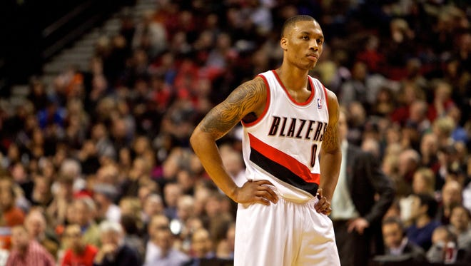 Blazers guard Damian Lillard, shown Jan. 21, leads rookies in points, assists and minutes per game.