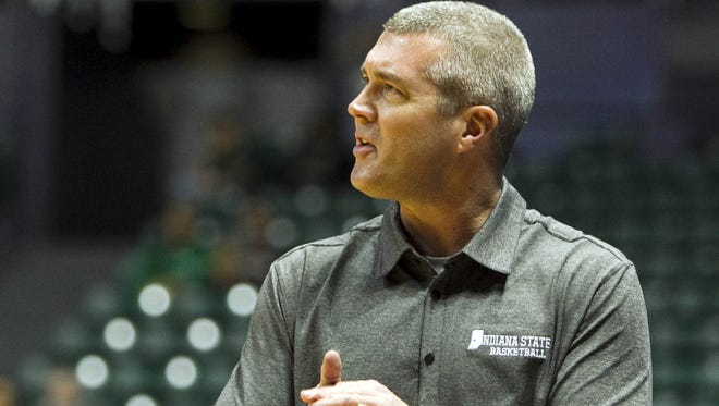 Indiana State Sycamores head coach Greg Lansing reacts to the action against the Miami Hurricanes during the first half of the consolation round of the Diamond Head Classic on Dec. 25, 2012.