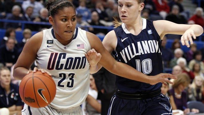 Connecticut Huskies forward Kaleena Mosqueda-Lewis drives the ball against Villanova Wildcats guard Katherine Coyer during the second half at the XL Center.