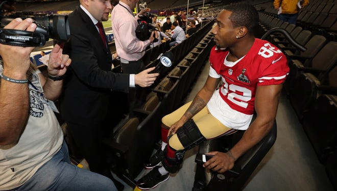 San Francisco 49ers wide receiver Mario Manningham is interviewed during media day in preparation for Super Bowl XLVII against the Baltimore Ravens.