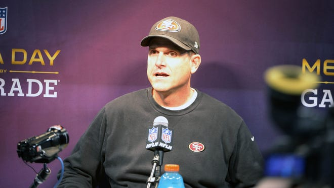 49ers coach Jim Harbaugh fields reporters' questions at Super Bowl XLVII media day.