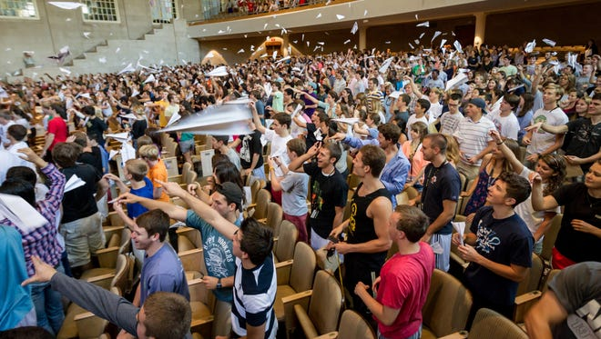 The Wake Forest Office of Personal and Career Development hosts an orientation program for new students. Students filled out a registration form, which they then folded into a paper airplane and submitted by throwing them toward the front of the chapel.