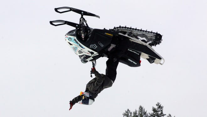 In a file photo from Jan. 27, 2008, Daniel Bodin, of Sweden, flips with his snowmobile during the Winter X Games at Buttermilk Ski Area near Aspen, Colo.