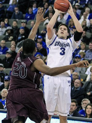 Creighton's Doug McDermott shoots over Missouri State's Gavin Thurman in the second half. Creighton beat Missouri State 91-77.