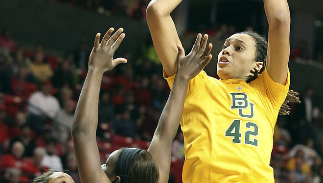 Baylor's Brittney Griner shoots over a pair of Texas Tech defenders in a 90-60 win. Griner set the Big 12 women's career scoring record.