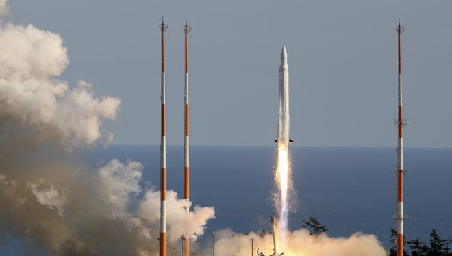 The South Korea Space Launch Vehicle-1 takes off from the launch pad at the Naro Space Center.