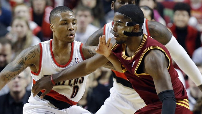 Cleveland Cavaliers guard Kyrie Irving, right, and Portland Trail Blazers guard Damian Lillard head up the Rising Stars Challenge team.