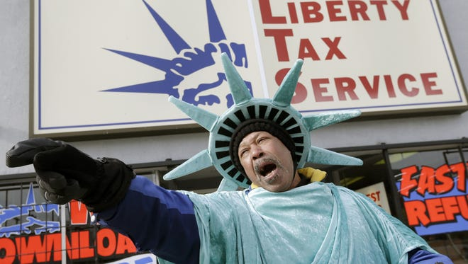 John Reed promotes Liberty Tax Service's   tax refund services in Buffalo, N.Y.