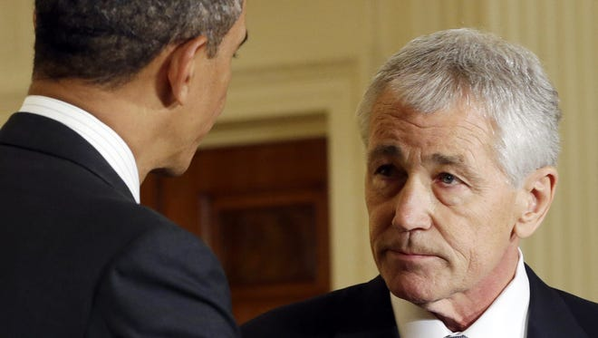 President Obama talks with his choice for Defense secretary, former Nebraska senator Chuck Hagel, after announcing Hagel's nomination at the White House on Jan. 7.