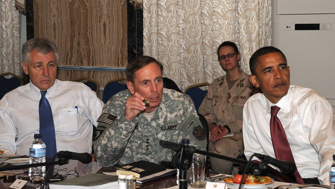 In 2008, Sen. Chuck Hagel, R-Neb., and Democratic presidential candidate Barack Obama visit Gen. David Petraeus and U.S. forces in Baghdad. Hagel is now President Obama's nominee to head the Pentagon.
