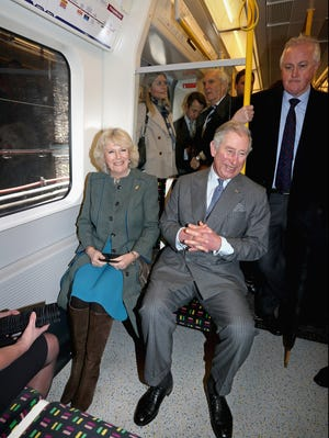 Prince Charles and his wife Camilla Duchess of Cornwall on the Tube to mark 150th anniversary of London Underground.