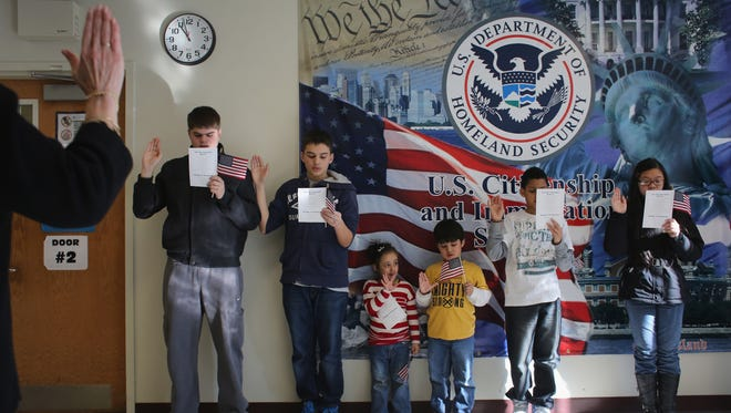 Children participate in a U.S. citizenship ceremony Tuesday in New York City.