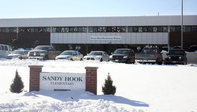 This photo provided by the Monroe Police Department shows the new Sandy Hook Elementary School on the first day of classes in Monroe, Conn, on Jan. 3.