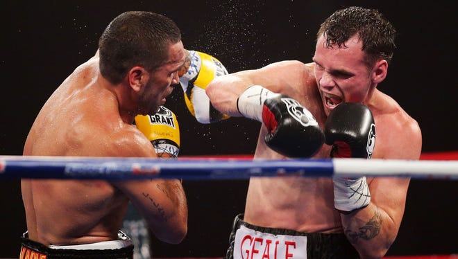 Daniel Geale, right,) lands a right on Anthony Mundine during their IBF middleweight title bout Wednesday. Geale defended his title.