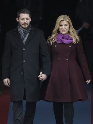 Kelly Clarkson arrives with Brandon Blackstock for the ceremonial swearing-in of President Barack Obama on Jan. 21 at the U.S. Capitol.