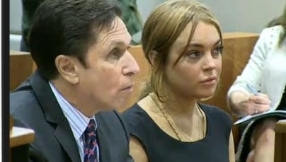 Linday Lohan and her attorney,  Mark Heller,  appear in a Los Angeles courtroom today.