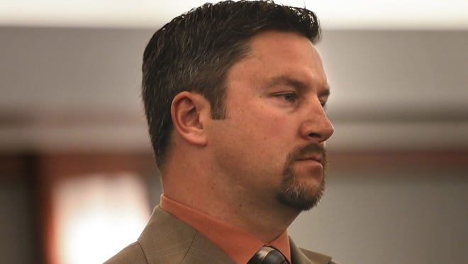 Michael McBain stands during his sentencing Wednesday in Regional Justice Center in Las Vegas.