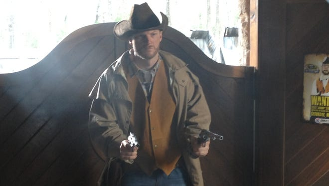 Dale Earnhardt Jr. plays the role of cowboy during a shoot for the 2013 Sprint All-Star Race commercial. The ad was filmed on the Western town located on Earnhardt's property.