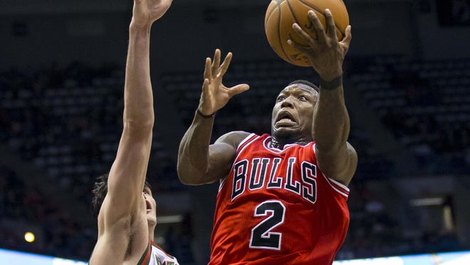 Chicago Bulls guard Nate Robinson drives for a shot as Milwaukee Bucks forward Ersan Ilyasova defends during the second quarter at the BMO Harris Bradley Center.