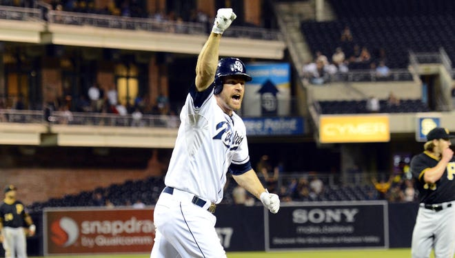 San Diego Padres third baseman Chase Headley celebrates after hitting a two-run walk off home run during the tenth inning against the Pittsburgh Pirates at Petco Park.