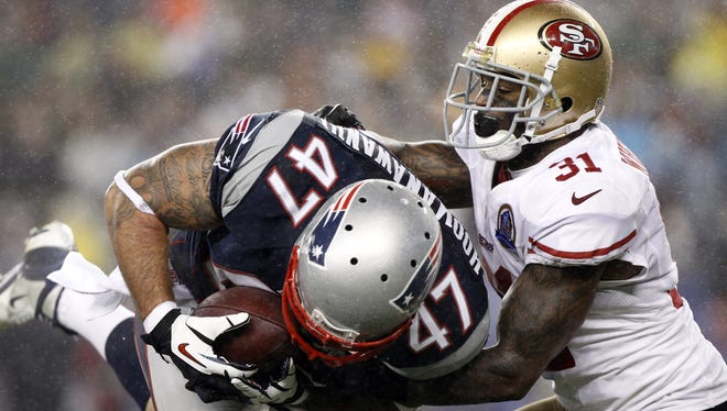 Niners S Donte Whitner (31) is careful about how he tackles larger opponents.