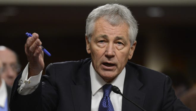 Former senator Chuck Hagel speaks at his confirmation hearing on Jan. 31.