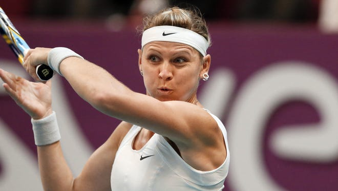 Lucie Safarova of the Czech Republic advance to the quarterfinals in Paris with a victory against Alize Cornet of France.